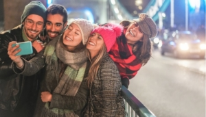 Happy Millennial friends: Posting organic content onto social networks like LinkedIn or Twitter.